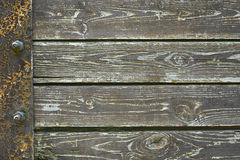 Wooden background from old plank boards with iron fastening, horizontal arrangement in a row Stock Photo