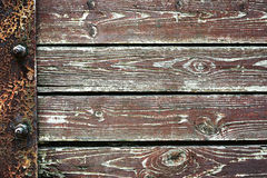 Wooden background from old plank boards with iron fastening, horizontal arrangement in a row Royalty Free Stock Images