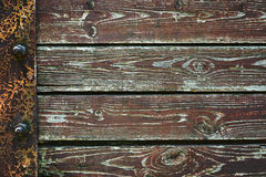 Wooden background from old plank boards with iron fastening, horizontal arrangement in a row Stock Photography