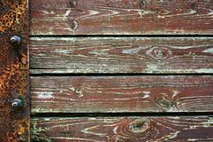 Wooden background from old plank boards with iron fastening, horizontal arrangement in a row Stock Images