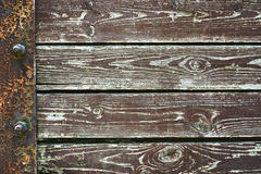 Wooden background from old plank boards with iron fastening, horizontal arrangement in a row Royalty Free Stock Photos