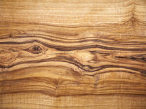 Wooden background, olive wood, wood grain Stock Images