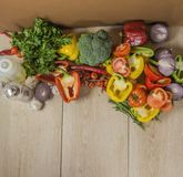 Wooden background with organic vegetables on the side, top view Royalty Free Stock Images
