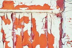 The wooden background is painted white, orange and brown with cracks and scratches. Abstract background. stock images