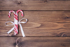 Wooden background with pair of Christmas candy canes Royalty Free Stock Photo