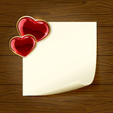 Wooden background with paper and heart Stock Photo