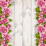 Wooden background with pink roses Stock Images