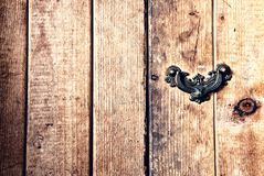 Wooden background with planking and small door handle. Light brown wooden background with planking and small door handle Royalty Free Stock Photo