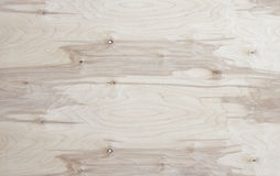 Wooden background. Of plywood with a beautiful pattern and knots of wood Stock Image