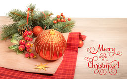 Wooden background with poinsettia and decorated Christmas tree. Twigs, text `Merry Christmas Royalty Free Stock Photos
