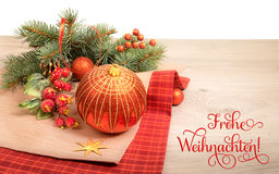 Wooden background with poinsettia and decorated Christmas tree,. Wooden background with decorated Christmas tree twigs, text on the picture means `Merry Stock Photo