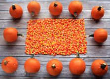 Rustic wooden  pumpkin and candy corn frame Royalty Free Stock Photography