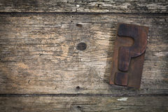 Wooden background with question mark printing block Royalty Free Stock Photography
