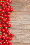 Wooden background with red berries Stock Image