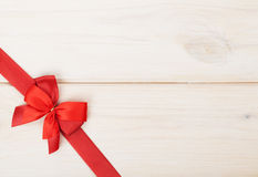 Wooden background with red bow and ribbon Stock Photo