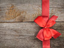 Wooden background with red bow and ribbon Royalty Free Stock Images