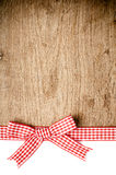 Wooden background with a red checkered ribbon Stock Images