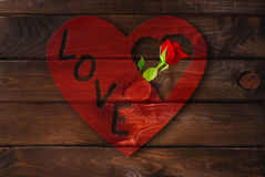 Wooden background with red heart and rose Royalty Free Stock Images