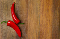 Wooden background with red hot chili peppers, horizontal Royalty Free Stock Image