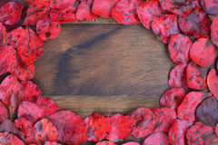 Wooden background with red leaves around Royalty Free Stock Photography