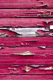 Wooden background with red peeling paint Royalty Free Stock Photos