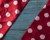 wooden background with red polka dot ribbon Royalty Free Stock Images