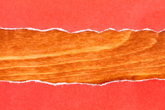 Wooden background with red torn paper Stock Images