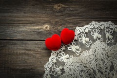 Wooden background with red velvet hearts Royalty Free Stock Photos