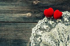 Wooden background with  red velvet hearts Stock Photography