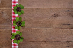 Wooden background with red and white checkered ribbon Stock Images