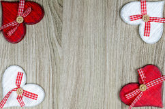 Wooden background with red and white hearts. Royalty Free Stock Image