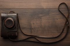 Wooden background with retro still camera Stock Photo