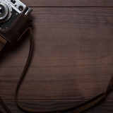 Wooden background with retro still camera Royalty Free Stock Image