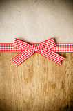 Wooden background, ribbon and kraft paper Stock Images
