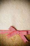 Wooden background, ribbon and kraft paper Stock Photos