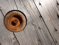 Wooden Background with Rusty Circle and Bolt Stock Image