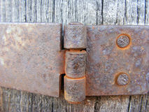 Wooden background and rusty hinge. Wooden background with rusty hinge Stock Image