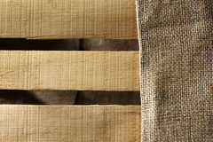 Wooden background with sackcloth Stock Photography