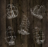 Wooden background with sailing ships Royalty Free Stock Photography