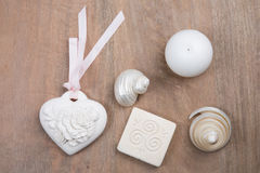 Wooden background with sea shells and hearts Stock Photos