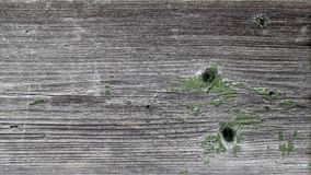 A wooden background with a shabby green paint Royalty Free Stock Image