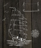 Wooden background with ship, wind rose and banner Royalty Free Stock Images