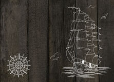 Wooden background with ship and wind rose Royalty Free Stock Photos