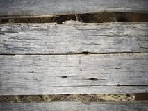 Rustic weathered barn wood background with knots and nail holes Stock Photos
