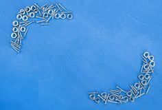 Wooden background with small metal parts. And place for text Royalty Free Stock Images