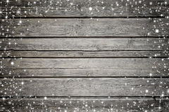 Wooden background with snow and stars Royalty Free Stock Images