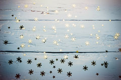 Wooden background with snowflakes and stars. Christmas and new year background Stock Photo