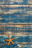 Wooden background with starfish Royalty Free Stock Photos