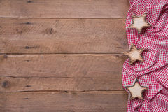 Wooden background with stars and a red checkered frame Stock Photos