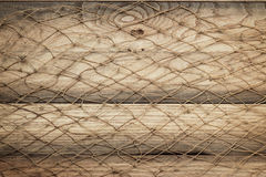 Wooden background texture and fishing net Royalty Free Stock Image